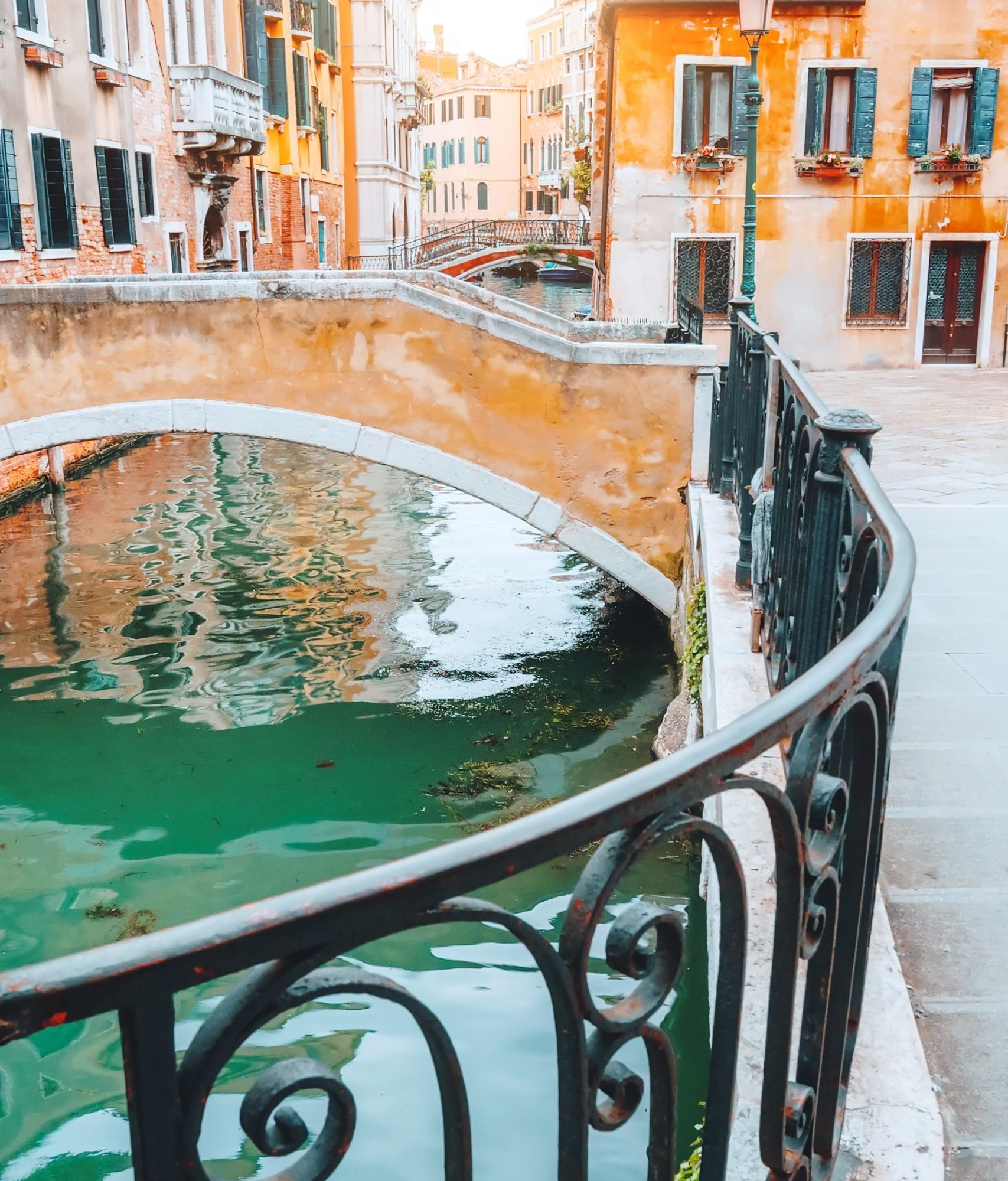 scenic-canal-with-bridge-and-colorful-buildings-in-FVSFK7H